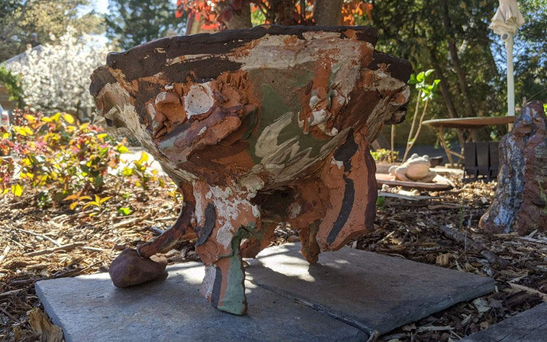 Things find their way to the garden: terracotta bird bath